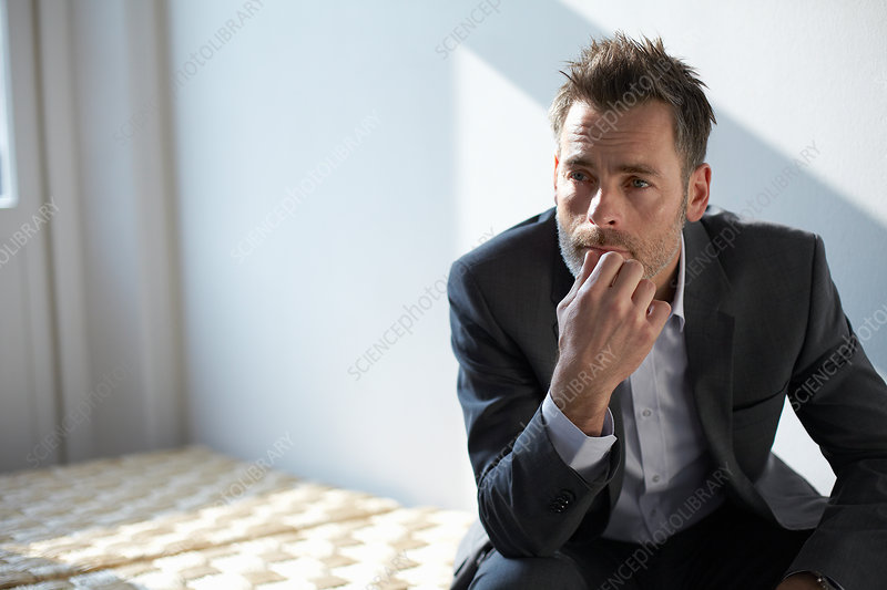 Businessman sitting on bench in office