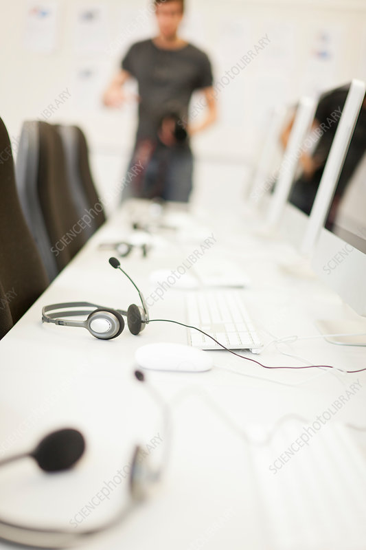 Headsets at computer desk in office
