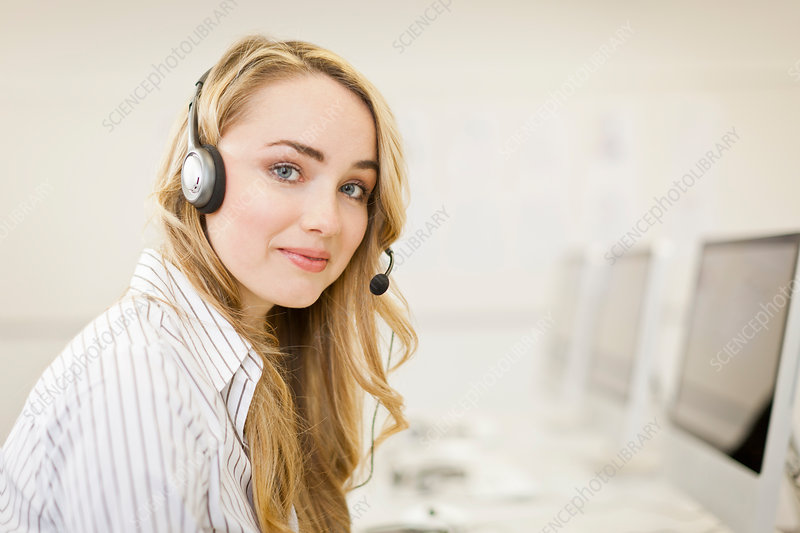Businesswoman working in headset