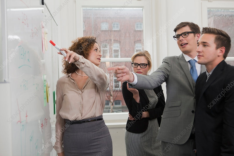 Businesswoman pointing to whiteboard