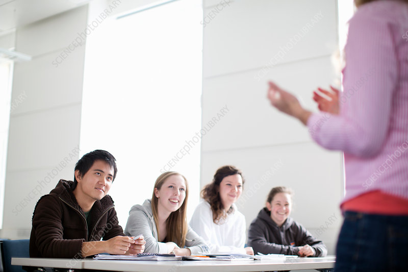 Teacher talking to students in class