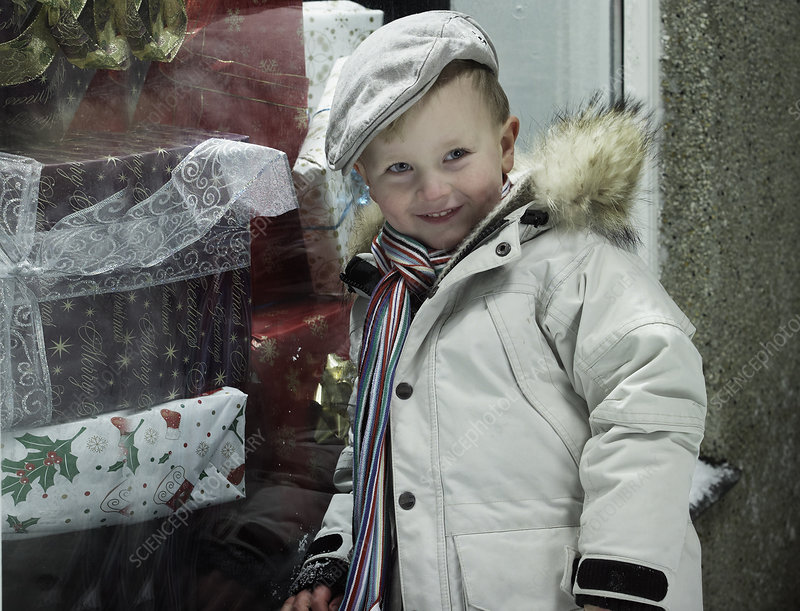 Smiling boy standing in snow