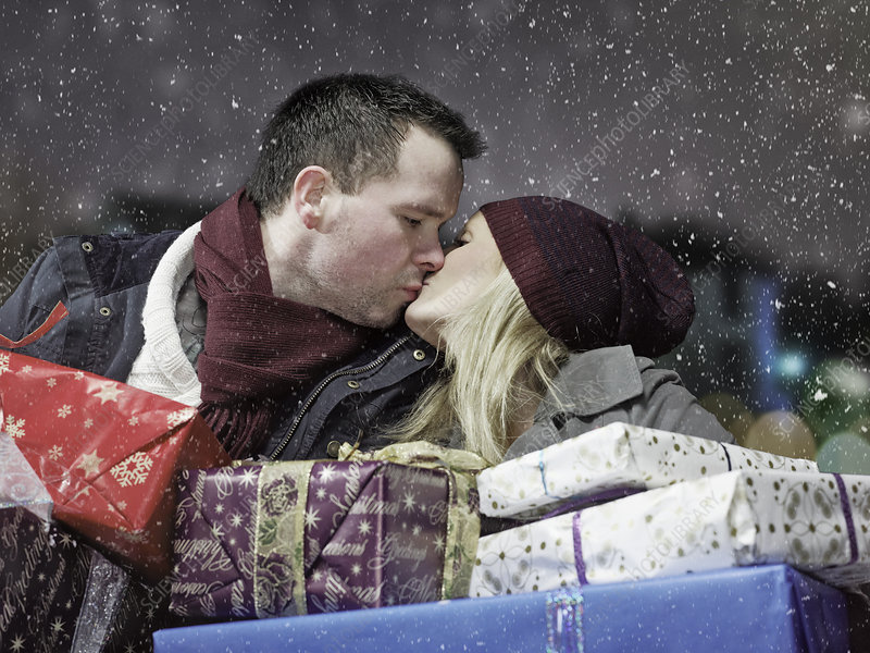 Kissing couple with Christmas gifts