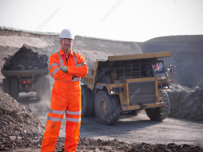 Worker standing at coal mine