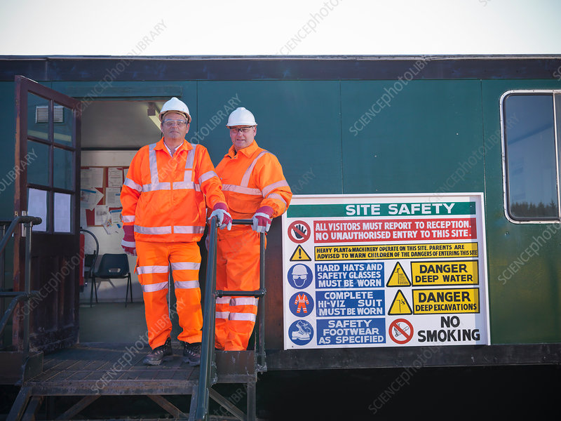 Workers by safety sign at coal mine
