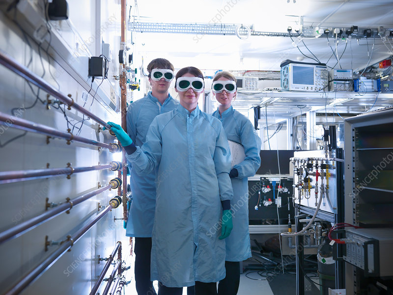Scientists wearing goggles in lab