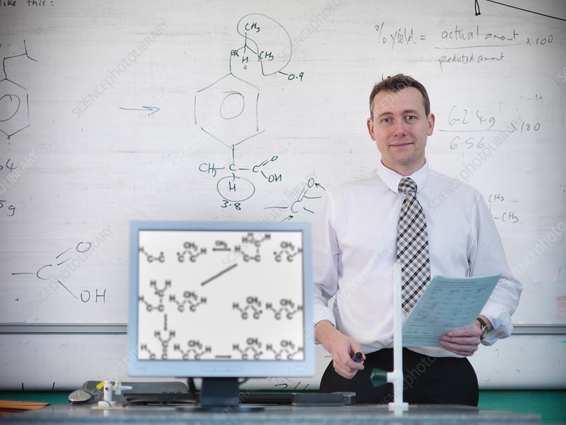 Science teacher at desk with computer