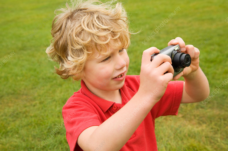 Boy taking pictures outdoors - Stock Image - F005/4668 ...