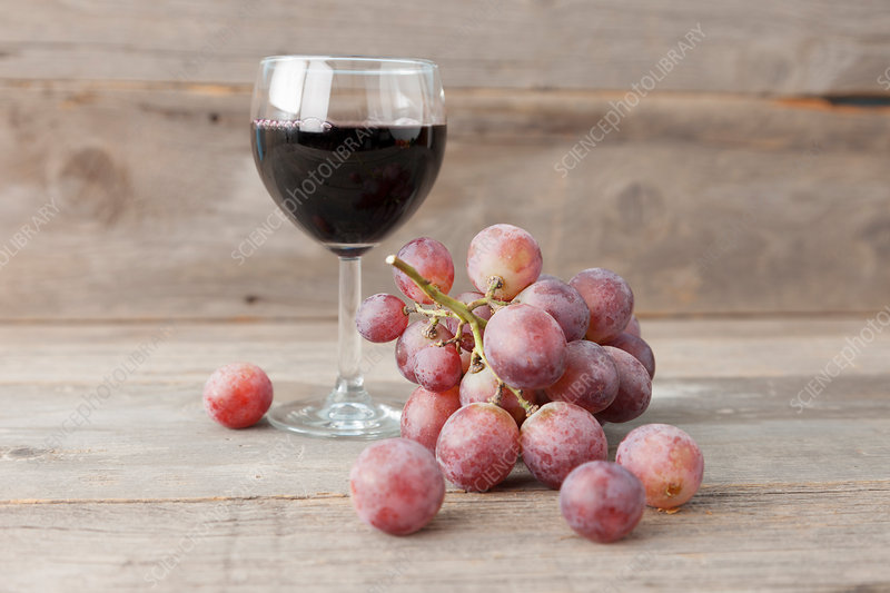 Close up of grapes and glass of wine