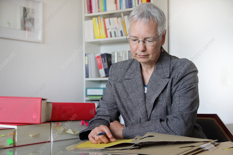 Lawyer reading notes in office
