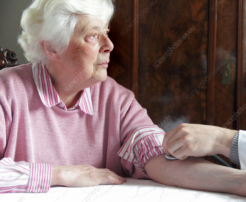 Older woman having pulse checked
