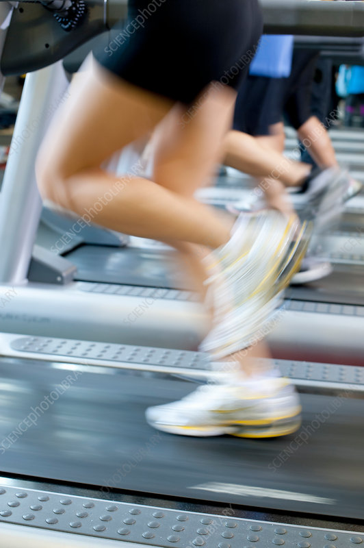 Blurred view of people on treadmills