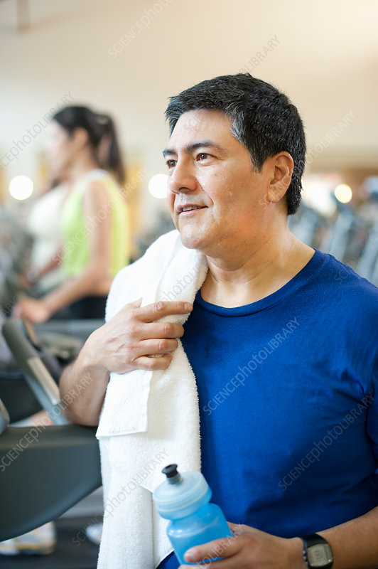 Older man towelling off in gym