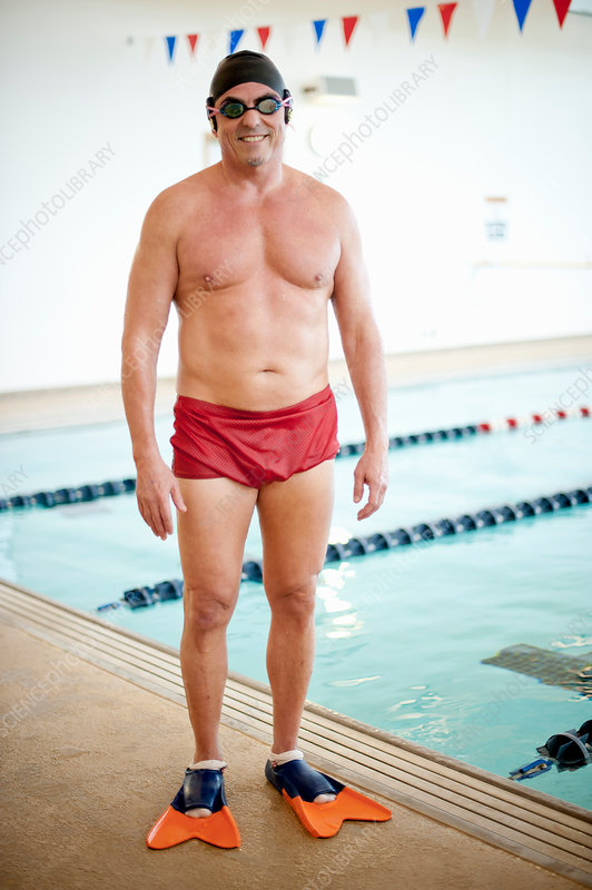 Man wearing swim gear at pool