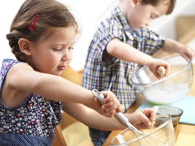Young children baking