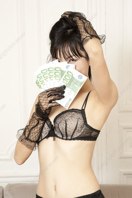 Woman in lingerie holding Euros