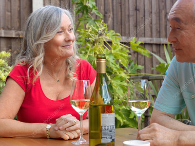 Older couple drinking wine together