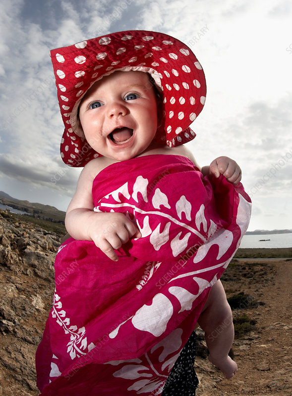Infant laughing on beach