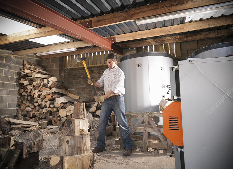 Man chopping wood in shed