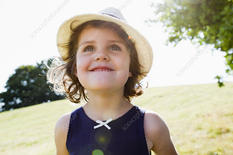 Smiling girl walking outdoors