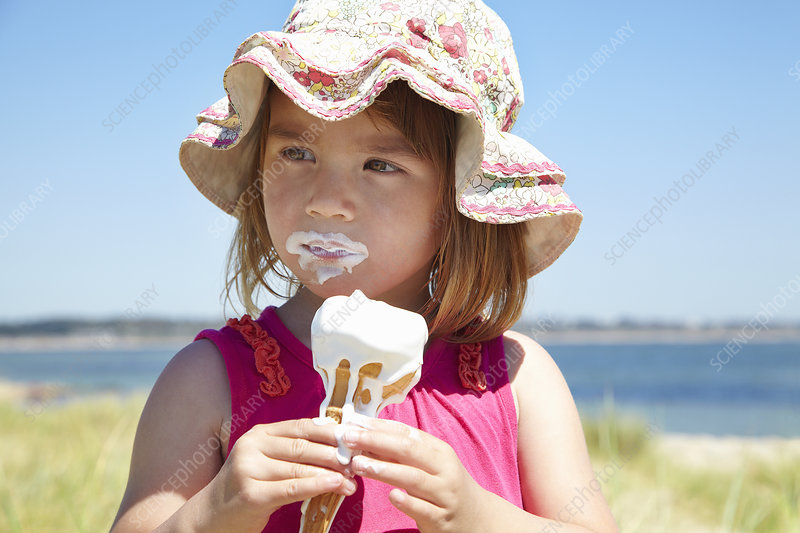 Girl eating ice cream on beach