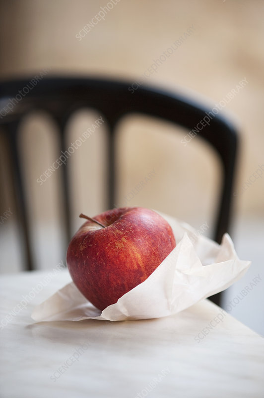 Close up of apple in paper bag