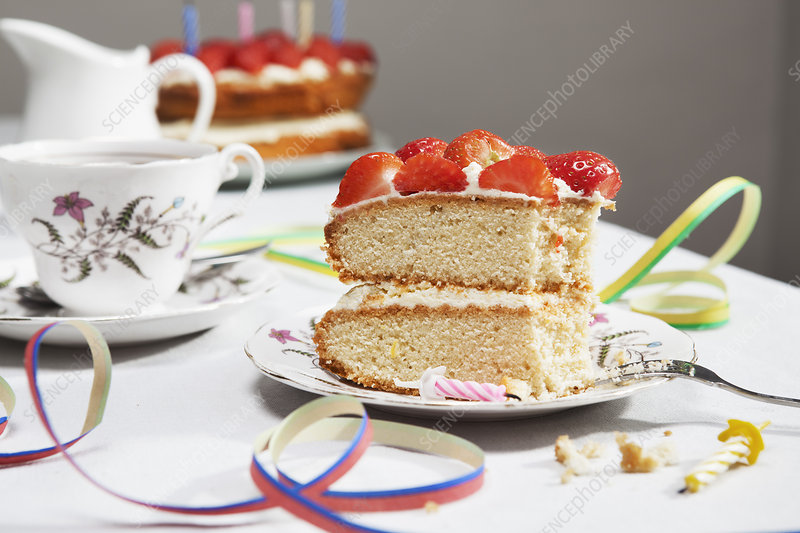Slice of birthday cake with tea