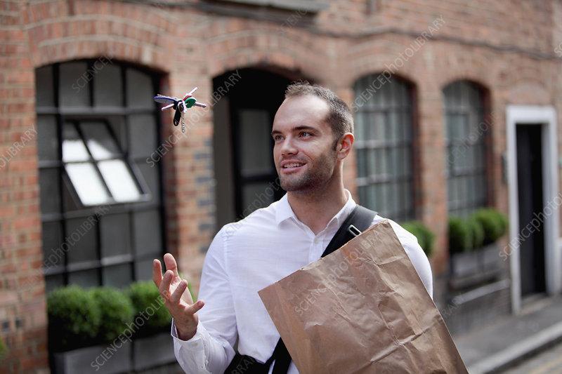 Businessman tossing keys in air