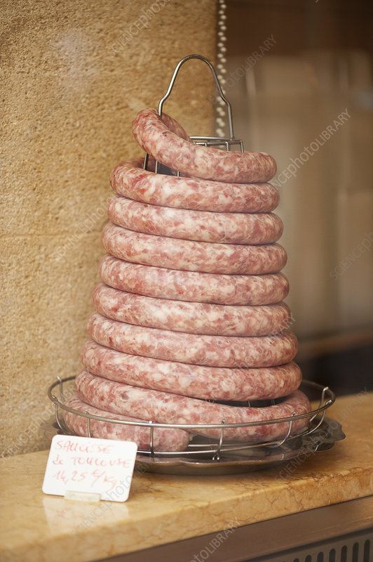 Coiled sausage in butchers shop