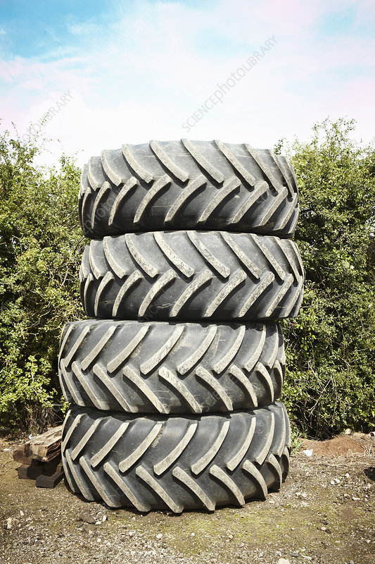 Tires stacked together in garden