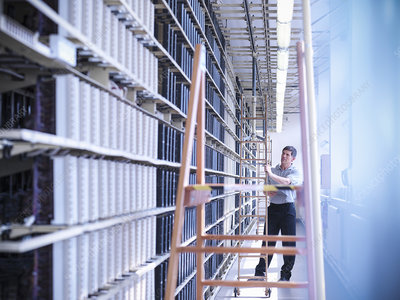 Man working in telephone exchange