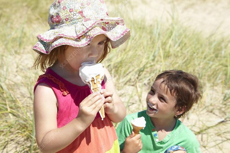 Children eating ice cream on beach