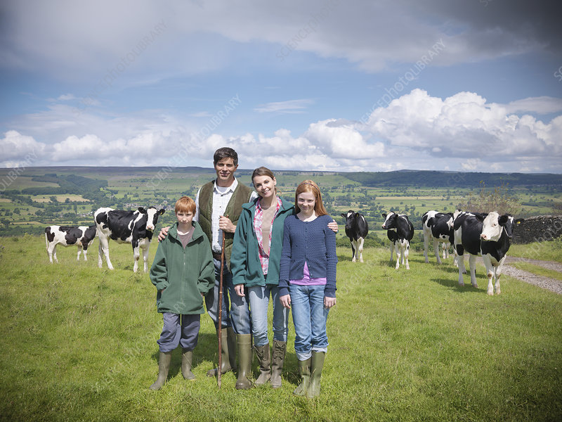 Farmer posing with family in field