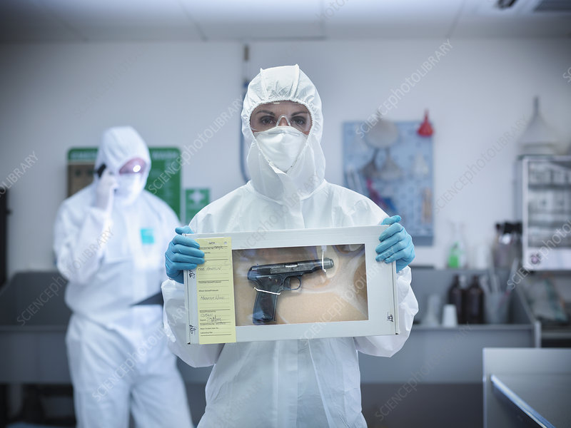 Forensic scientist with gun in box
