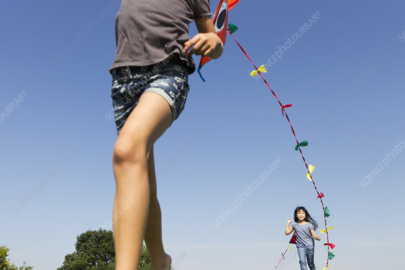 Children playing with kites outdoors
