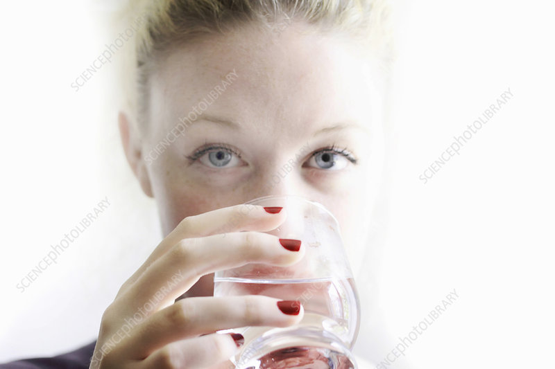 Close up of woman drinking glass of wine