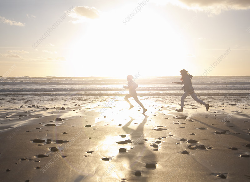 Mother and son running on beach