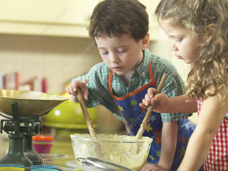 Children baking together in kitchen