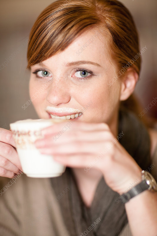 Smiling woman with milk moustache