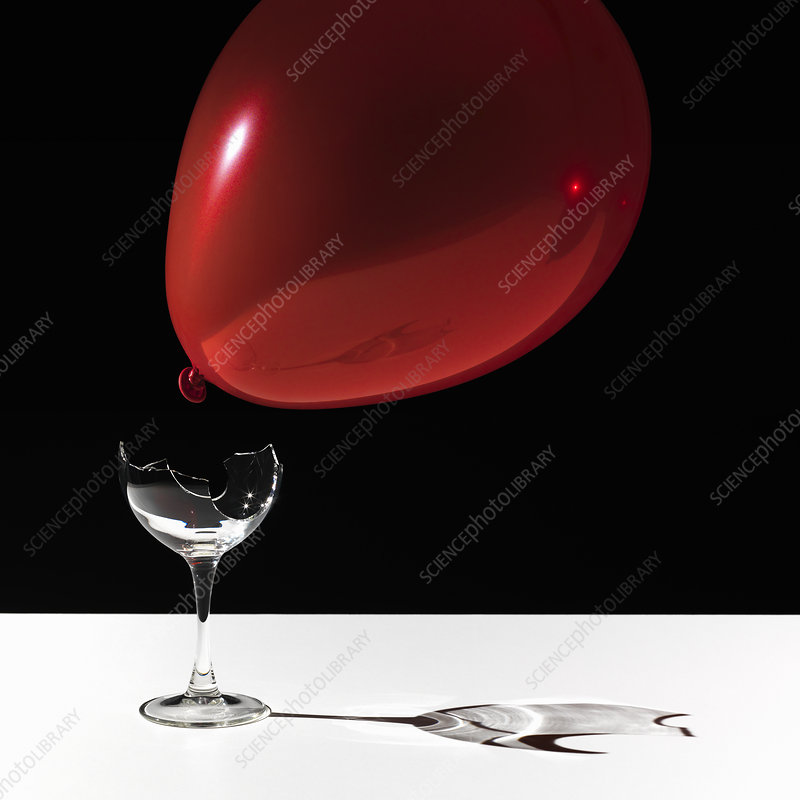 Balloon hovering over broken glass