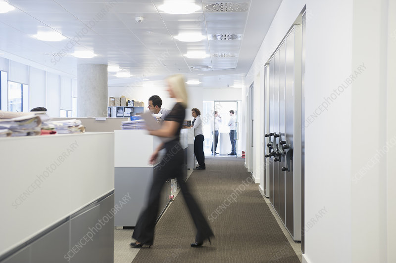 Blurred view of businesswoman in office