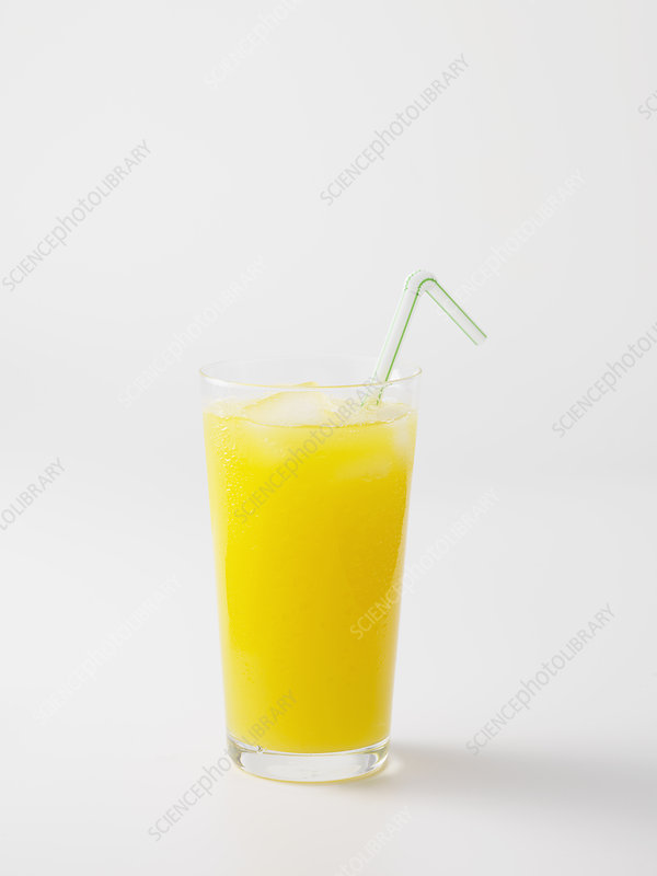 Straw in glass of orange juice