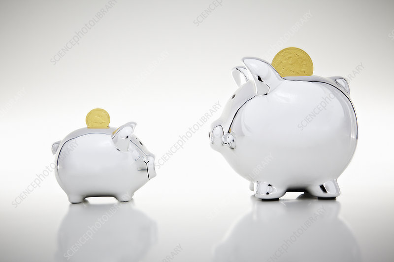 Gold coins dropping into piggy banks