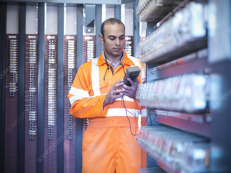 Railway worker checking circuits