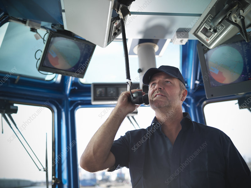 Tugboat captain working in wheelhouse