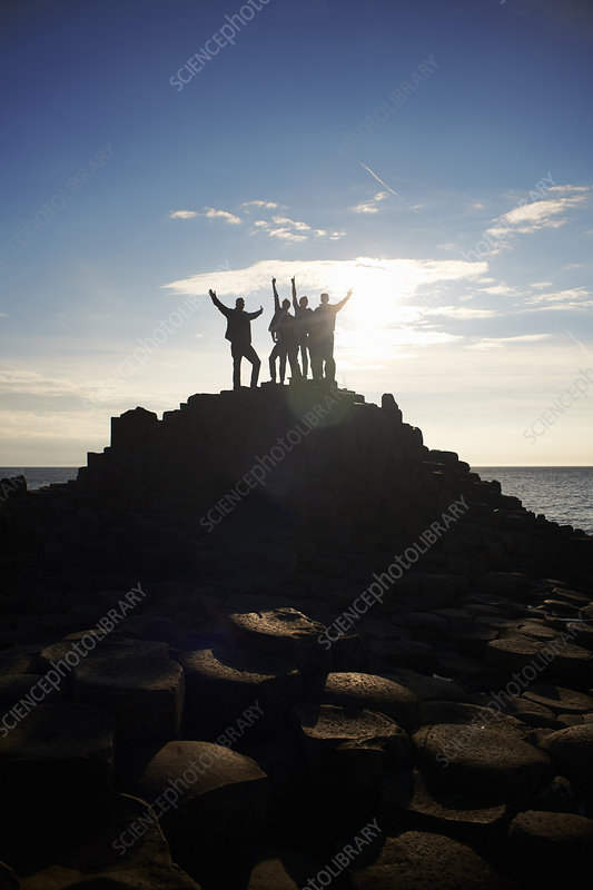 Silhouette of people on Giant's Causeway