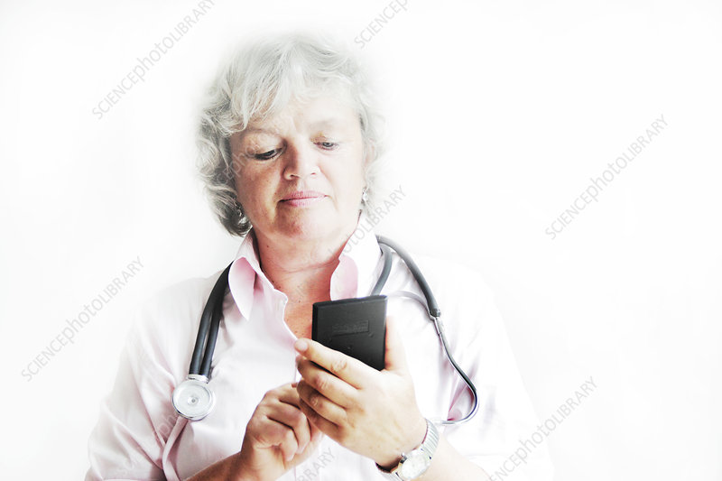 Doctor using calculator in office