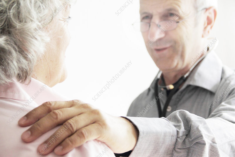 Doctor with hand on patient's shoulder