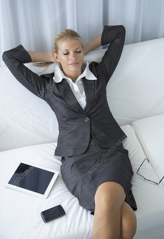 Businesswoman relaxing on sofa