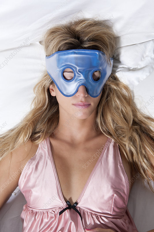 Woman sleeping with face mask in bed